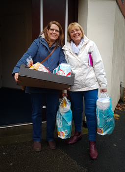 2 women with food parcels